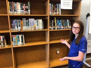 Student pointing to empty shelves